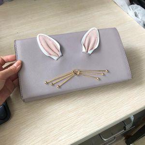 Kate Spade 凯特·丝蓓少女兔耳朵真兔毛尾巴挎包手包