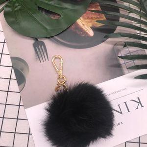 Michael Kors迈克高仕黑色毛球球钥匙扣挂件