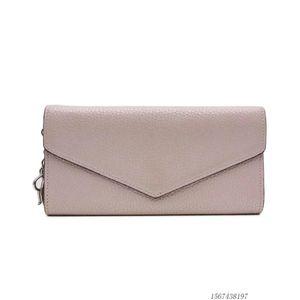 Dior 迪奥粉色皮质长款按扣钱包