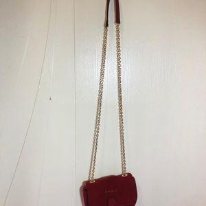 COCCINELLE 可奇奈尔红色麂皮手提包