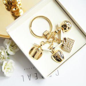 Dior迪奥宝瓶闪金钥匙扣挂件