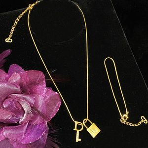 Dior 迪奥全包金镶钻锁头钥匙吊坠首饰套装