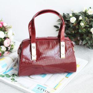 Dior 迪奥ST11228酒红漆皮压纹小号手提包