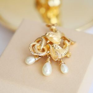 Dior 迪奥XL08116珍珠闪亮金鱼胸针