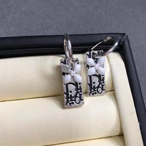 Dior 迪奥陶瓷花耳钉