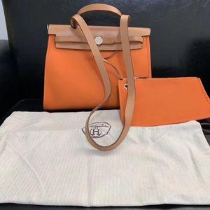 Hermès 爱马仕橙色herbags31手提包