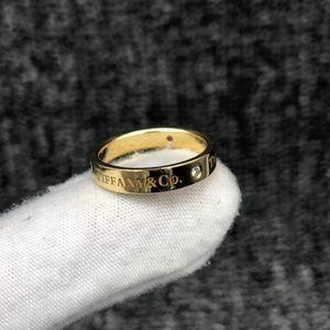 Tiffany & Co. 蒂芙尼AU750材质黄金色三钻戒指