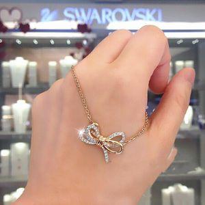 SWAROVSKI 施华洛世奇蝴蝶结双色两用流苏项圈锁骨项链