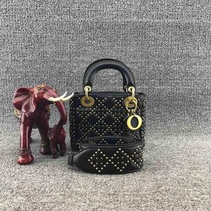 Dior 迪奥经典三格金属饰钉皮革戴妃手提包