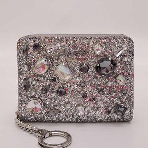 Kate Spade 凯特·丝蓓女士限量璀璨宝石拉链手拿包