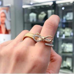 SWAROVSKI 施华洛世奇双色蝴蝶结水晶戒指