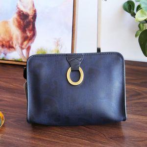 Dior 迪奥SN12024PVC材质墨蓝大金扣手拿包