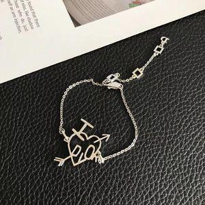 Dior 迪奥女经典字母一箭穿心镀金手链