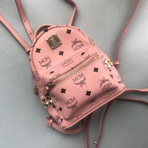 MCM   粉色超mini双肩包