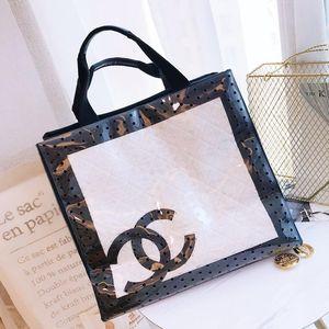 CHANEL 香奈儿镂空黑白拼色购物袋