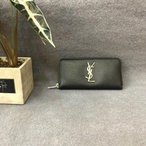 Yves Saint Laurent 伊夫·圣罗兰黑色鱼子酱牛皮拉链钱包