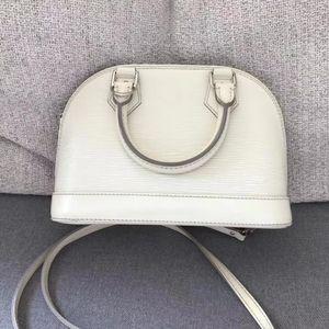 Louis Vuitton 路易·威登白色水波纹手提包