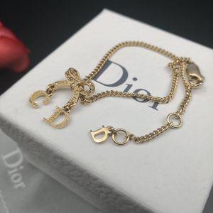 Dior 迪奥金色满钻蝴蝶结CD Logo手链