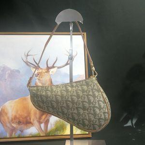 Dior 迪奥ST12584绣花帆布马鞍包手提包