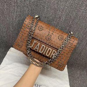 Dior 迪奥棕色铆钉链条包