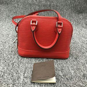 Louis Vuitton 路易·威登alma nano红色水波纹手拎斜挎贝壳包