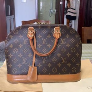 Louis Vuitton 路易·威登贝壳手提包