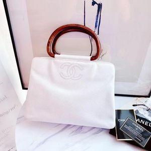 CHANEL 香奈儿白色荔枝皮手提包