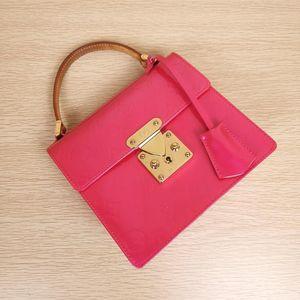 Louis Vuitton 路易·威登漆皮玫红色Kelly spring手提包