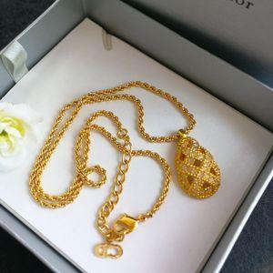 Dior 迪奥XL12002闪钻镀金菠萝艺术坠金丝项链锁骨链