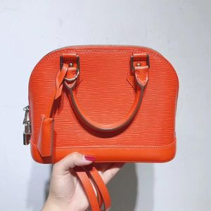 Louis Vuitton 路易·威登橘色水波纹手提单肩包