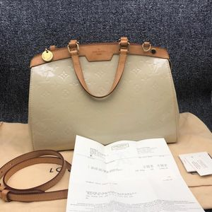 Louis Vuitton 路易·威登女士漆皮单肩斜背手提包