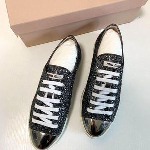Miu Miu 缪缪银色亮片平底鞋