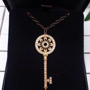 Tiffany & Co. 蒂芙尼黄金镶钻大号圆形花瓣钥匙吊坠项链