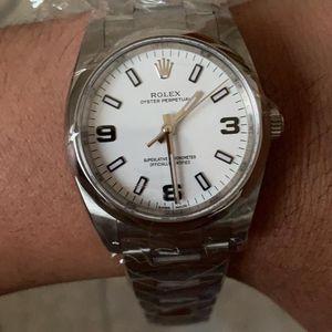 Rolex 劳力士114200-70190白盘机械表