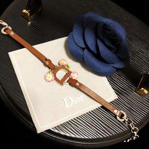 Dior 迪奥限量款大D扣炫彩滴釉山茶花真皮手环