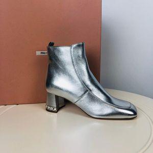 Miu Miu 缪缪银色水晶短靴