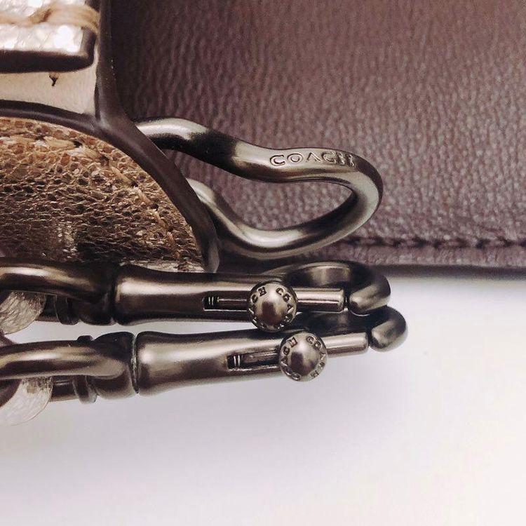 COACH 蔻驰1941牛皮旋转扣翻盖两用单肩包