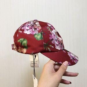GUCCI 古驰丝绸花卉帽子