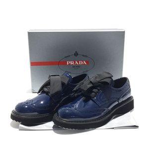 PRADA 普拉达蓝黑色英伦风皮鞋