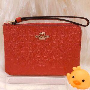 COACH 红色纯牛皮浮雕奢华手拿包