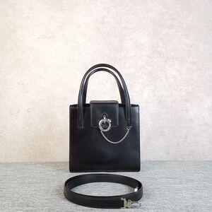 Cartier卡地亚女士黑银豹子头单肩手提包