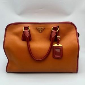 PRADA 普拉达女士橘红拼色手提包