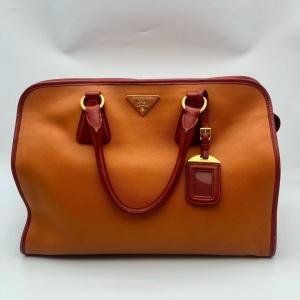 PRADA 普拉达女士橘色拼色手提包