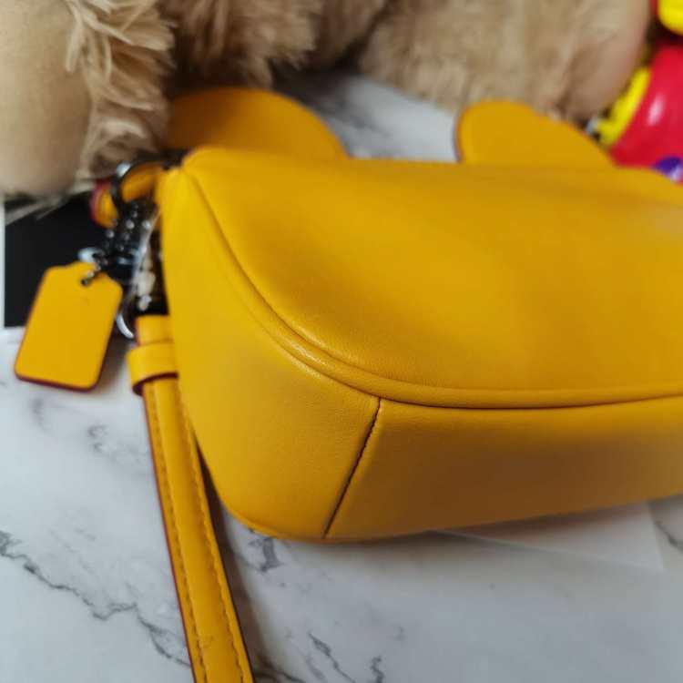 COACH蔻驰女士手包黄色米奇迪士尼手拿包钱包